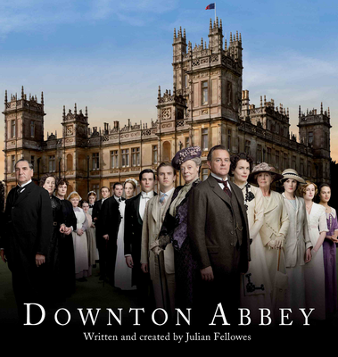 the giant old fancy house from Downton Abbey with the entire cast, about 20 white people in various stages of fancy dress, standing in front